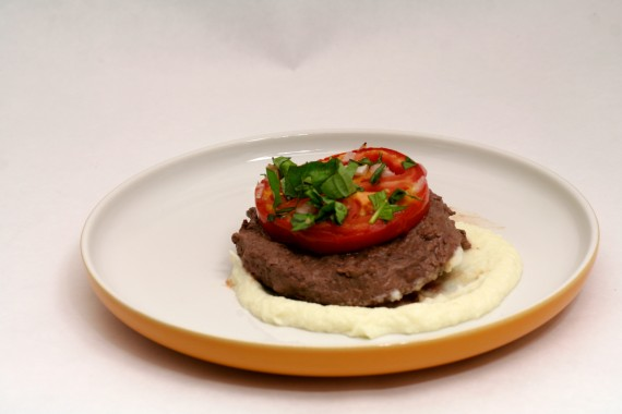 Buttered Cauliflower Puree topped with grass fed bison and Baked Tomatoes Provencal