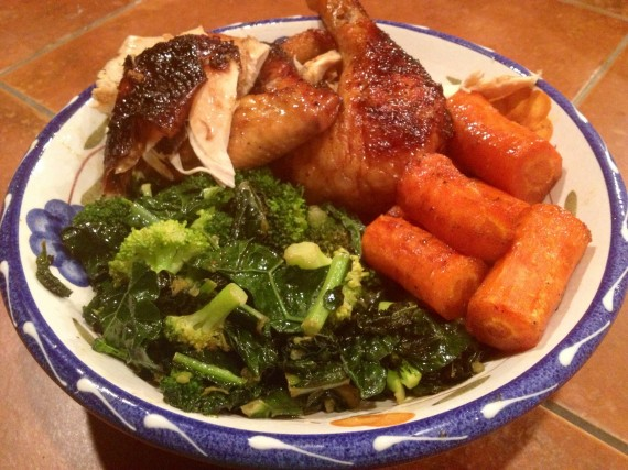 Garam Masala Orange Chicken served with carrots and greens.