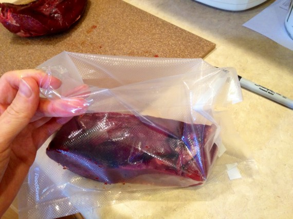 FoodSaver bag folded over on top prior to putting grass fed organic heart into it.