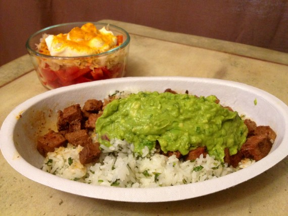 Chipotle Bowl with white rice, steak, and guacamole.