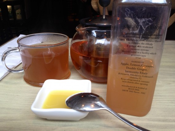Blue Dog Cafe (NYC) herbal tea with fresh pressed ginger juice and cold pressed bottled juice.