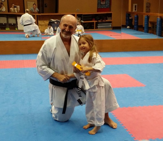 Kamea receiving her yellow belt.