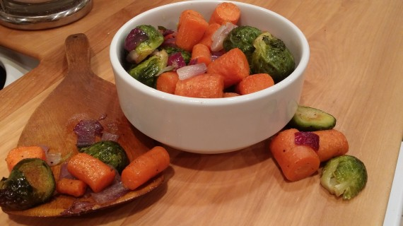 Roasted Brussels sprouts, carrots, and purple onion in ghee.