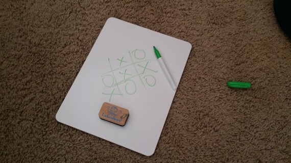 Tic Tac Toe on a dry erase white board is fun.