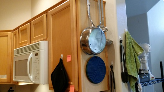 Mmmm yeah. More hooks. Pan, hot pad things, and hanging ladles from the top of cupboard.