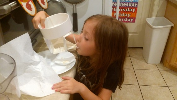 My kid licking the ice cream maker. Loving it. #GrassfedGoodness