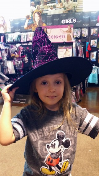 "Trying on a witch hat. ""I'll get you my pretty…"""