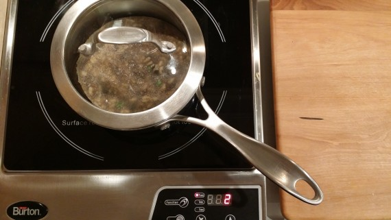 Nifty glass lid on cute little pot on induction hot plate. Love induction.