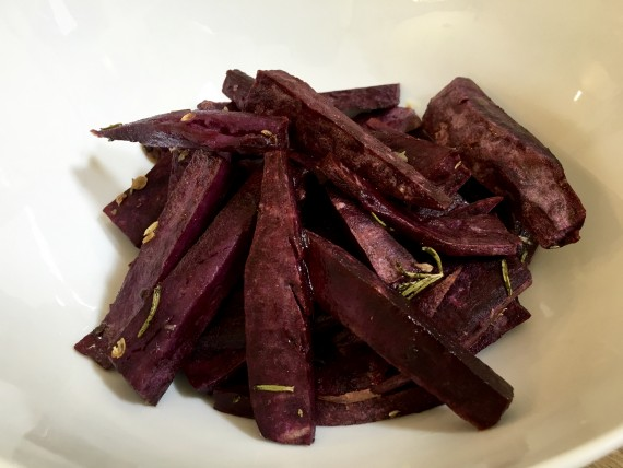 Purple sweet potato wedges, roasted.