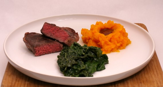 Grass fed bison steak, mashed butternut squash, and kale