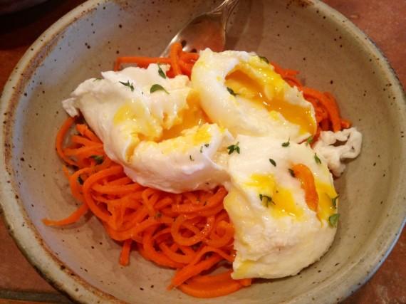 Each egg broken open so the yolk can run over the nested carrots. Perfection.