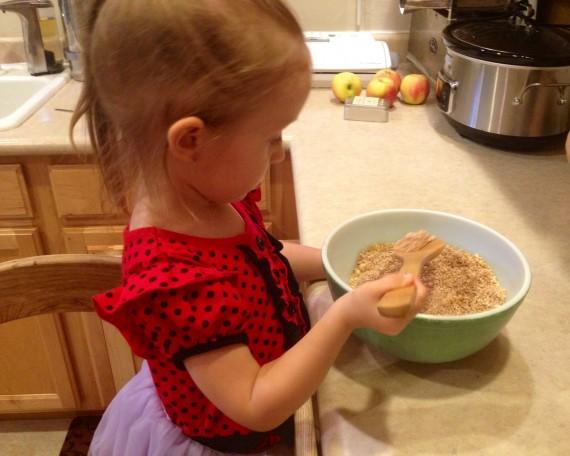 Kamea helping me in the kitchen make Cinnamon Sugar Bread