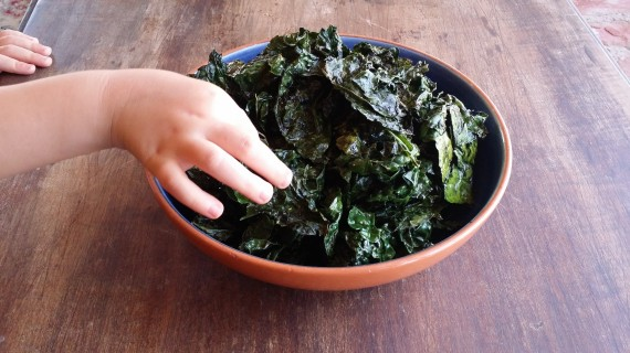 Roasted Kale with Ghee and a little kiddo's hand grabbing for some.