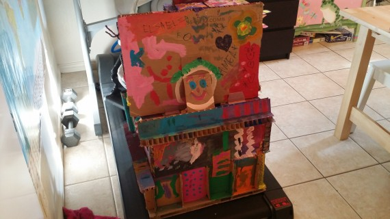 A work in progress - various cardboard pieces glued together to make a castle(?) and we paint on it regularly.